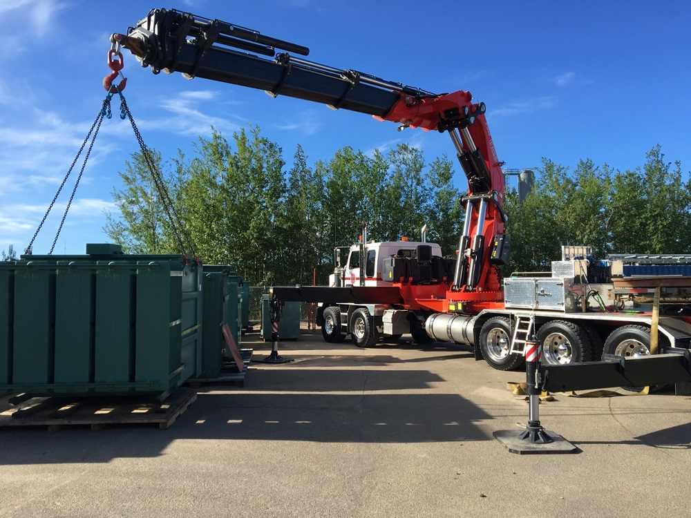 Our next cranes are the 45-50 ton category. The knuckles all pull trailers, and some of the straight booms as well. These are tandem triple units, with up to 155 ft of hydraulic reach available. With jibs that puts us over 200 ft of peak height. Specialty Services.